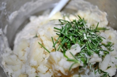 Add the herbs and potatoes