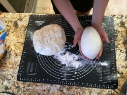 Pull the sides under the loaf to form loaves