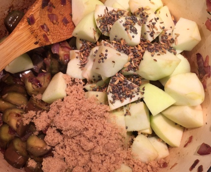 Add apples, brown sugar, spices, tomatoes, and juice