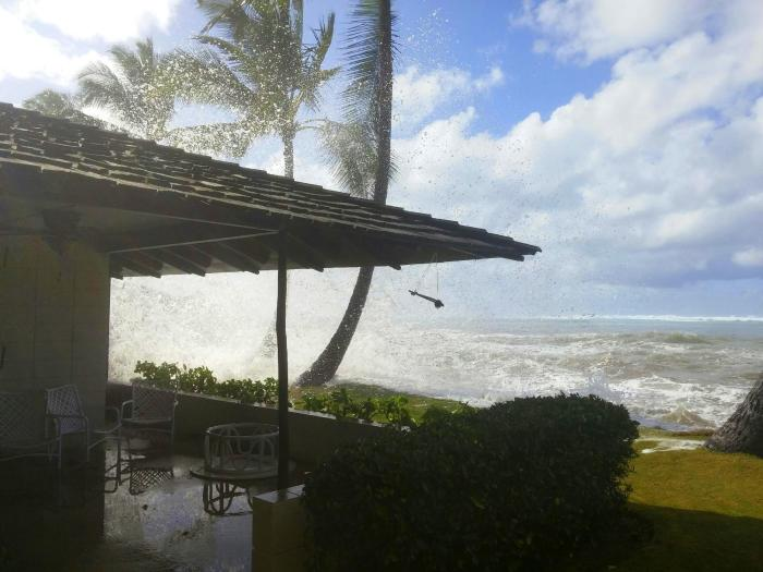 We are having our own inclement weather here too but it is in the form of extremely high surf. To give you an idea, there is usually an 8 foot drop down to the ocean right in front of the palm tree!