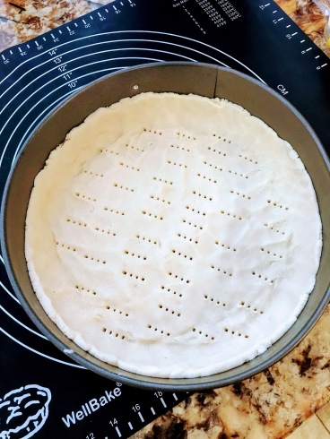 Poke holes in the crust to all the air to escape during blind baking